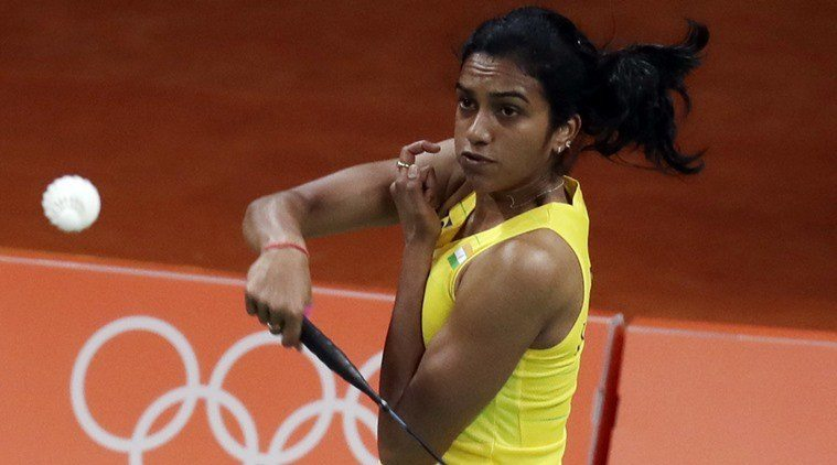 India's Sindhu Pusarla returns a shot against Hungary's Laura Sarosi during a women's badminton match at the 2016 Summer Olympics in Rio de Janeiro, Brazil, Thursday, Aug. 11, 2016. (AP Photo/Kin Cheung)
